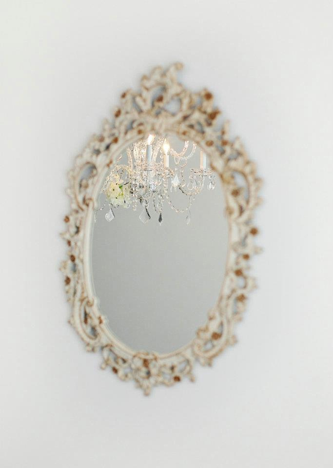 vintage mirror with chandelier reflection